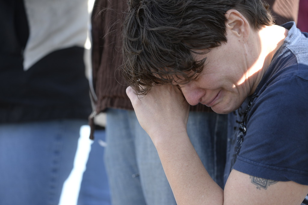 . CENTENNIAL, CO. - DECEMBER 13: Paige O\'Hanlon waits for weeps after confirming her daughter is safe outside Arapahoe High School in Centennial, CO December 13, 2013. A student who carried a shotgun into Arapahoe High School and asked where to find a specific teacher opened fire on Friday, wounding two fellow students before apparently killing himself, Arapahoe County Sheriff Grayson Robinson said. (Photo By Craig F. Walker / The Denver Post)
