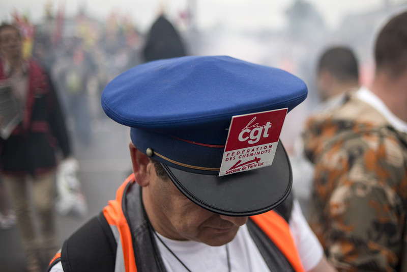 . A man wearing a train driver\'s cap takes part in a demonstration by striking workers of the French state-run rail operator SNCF, backed by French unions CGT and Sud-Rail, against reform plans proposed by the French government on June 17, 2014 in Paris. France\'s longest rail strike in years rolled on for a second week as lawmakers were set to debate a contentious debt-cutting reform plan opposed by unions.  (FRED DUFOUR/AFP/Getty Images)