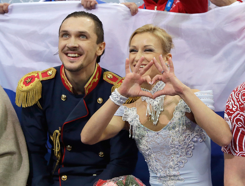 . Maxim Trankov and Tatiana Volosozhar of Russia wait for their score after competing in the Figure Skating Pairs Short Program during the Sochi 2014 Winter Olympics at Iceberg Skating Palace on February 6, 2014 in Sochi, Russia.  (Photo by Darren Cummings/Pool/Getty Images)