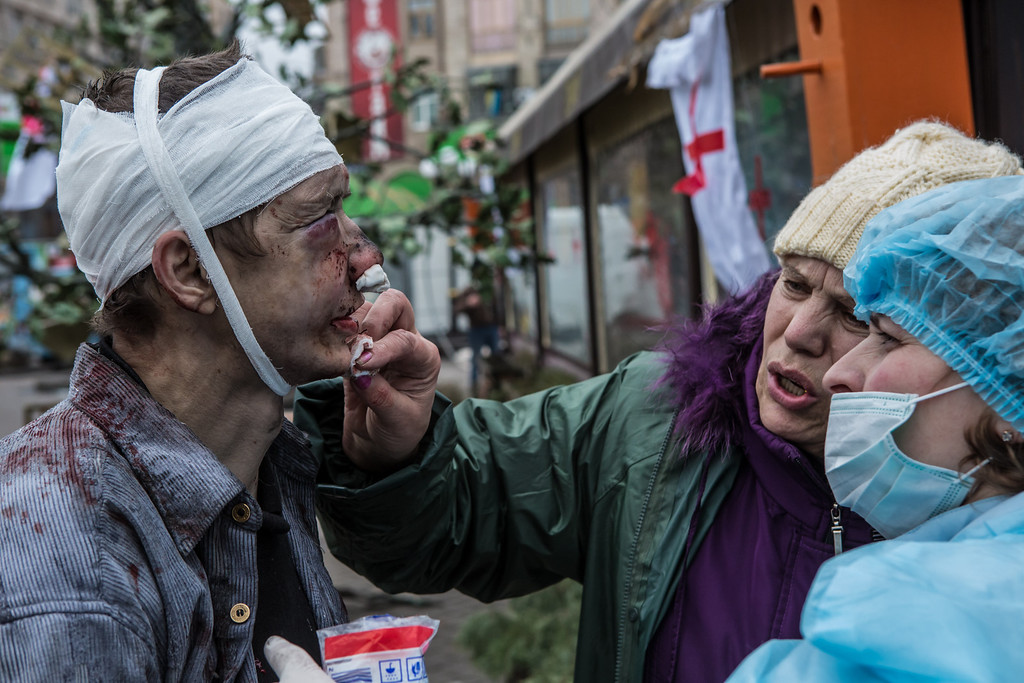 . A wounded anti-government protester is treated by medics near Independence Square on February 20, 2014 in Kiev, Ukraine.  (Photo by Brendan Hoffman/Getty Images)