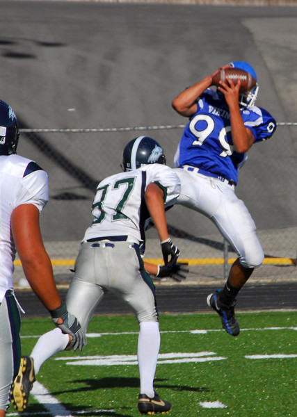 9/27/07 – Sean had another blow out Junior Varsity football game. They played their big rival, Timpanogos High. They won easily 27 to 0. It was Timps homecoming, so Pleasant Grove enjoyed the win even more than normal. Sean was on offense and caught this pass for a big gain on third down. He also played defense and sacked the QB a little earlier for a big loss. He had a great game.