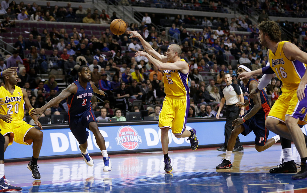 . Los Angeles Lakers guard Steve Blake (5) passes the ball during the first quarter of an NBA basketball game against the Detroit Pistons at the Palace in Auburn Hills, Mich., Friday, Nov. 29, 2013. (AP Photo/Carlos Osorio)