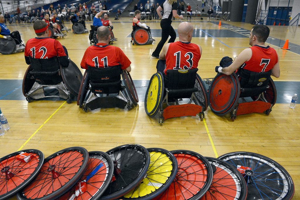 . DENVER, CO. - FEBRUARY 10: Matt Gypin (12) Rob Schuler (11) A-Jay Nagle (13) and Jason Regier (7) of the Denver Harlequins watch the action from the sideline during their game against the Northridge Knights during the Wheelchair Rugby Tournament February 10, 2013 at Englewood High School.  The Mile High Mayhem was put on by Craig Hospital and city of Englewood.(Photo By John Leyba/The Denver Post)