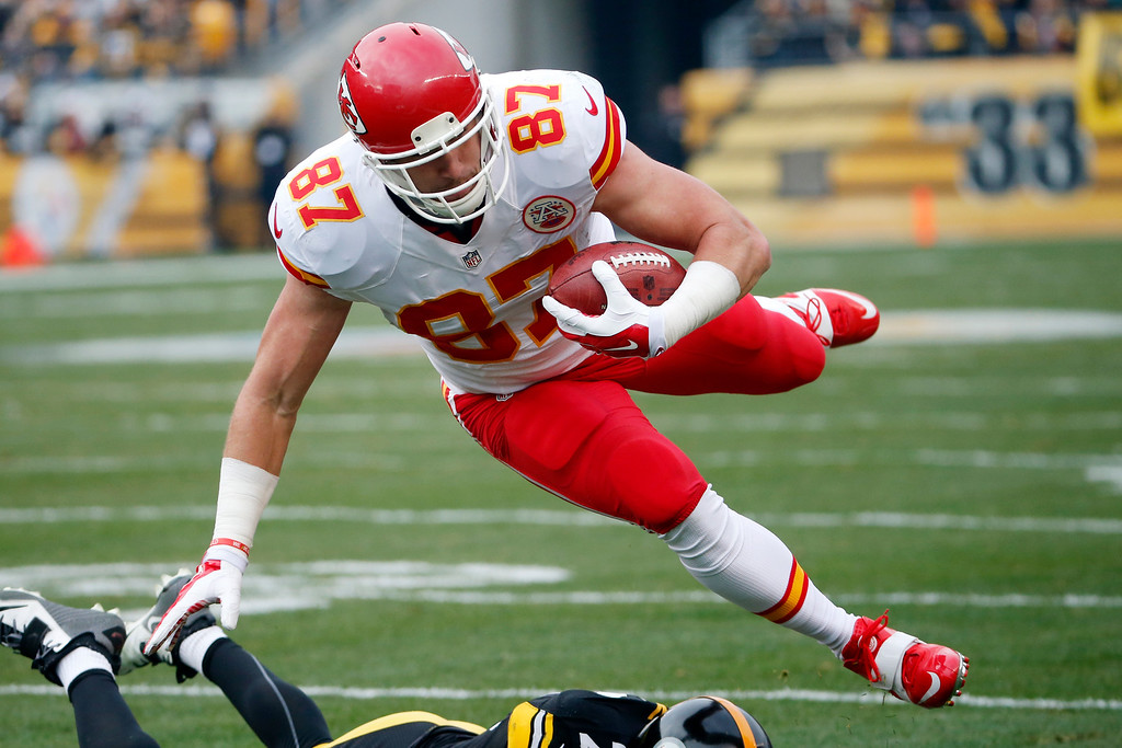 . Kansas City Chiefs tight end Travis Kelce (87) is tackled by Pittsburgh Steelers cornerback William Gay, bottom, during the first half of an NFL football game in Pittsburgh, Sunday, Dec. 21, 2014. (AP Photo/Tom Puskar)