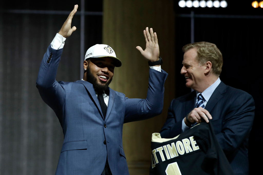 . Ohio State\'s Marshon Lattimore, left, reacts with NFL commissioner Roger Goodell after being selected by the New Orleans Saints during the first round of the 2017 NFL football draft, Thursday, April 27, 2017, in Philadelphia. (AP Photo/Matt Rourke)