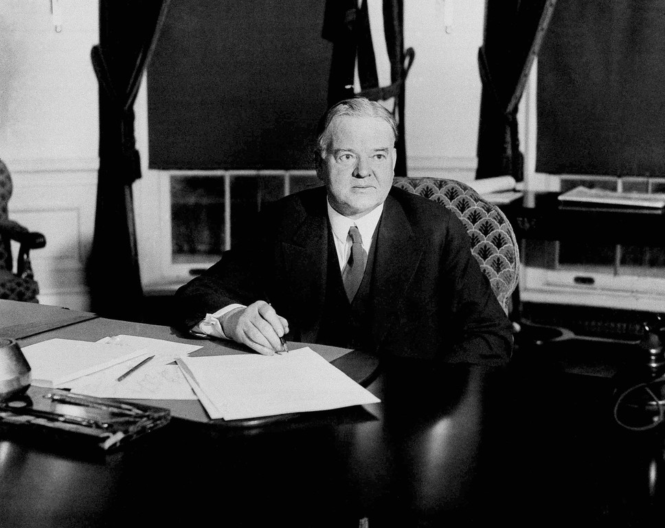 . President Herbert Hoover signs the unemployment and drought relief bills providing a total of $161,000,000 for providing work for the jobless and seed fertilizer and, possibly, food for farmers of the drought area, Dec. 20, 1930. The unemployment bill creates an emergency fund of $116,000,000 to be expended on the construction of federal buildings, road and waterways. The $45,000,000 carried in the drought relief bill is for loans to farmers.  (AP Photo)