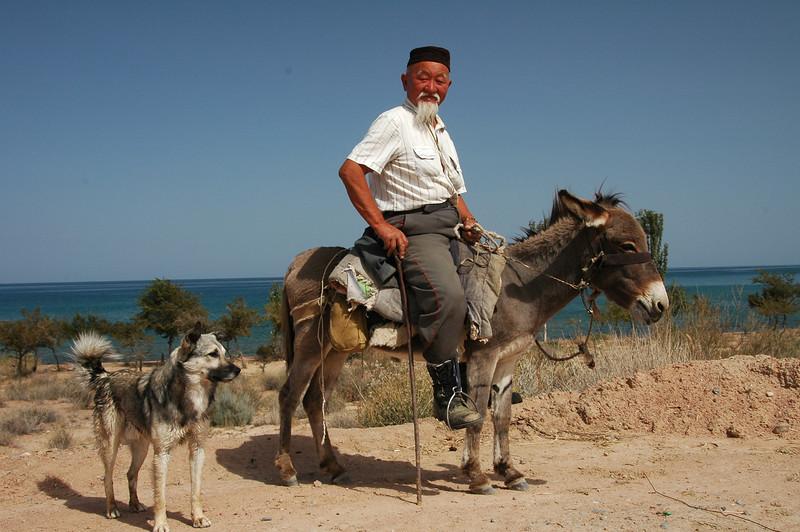 Kyrgyz Man, Donkey and Dog - Lake Issyk-Kul, Kyrgyzstan