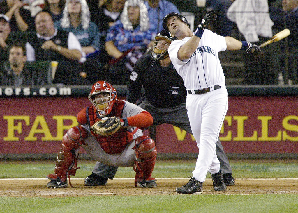 . EDGAR MARTINEZ -- All eyes are on a long foul ball hit by Seattle Mariners designated hitter Edgar Martinez on Sept. 15, 2004, during a game against the Anaheim Angels at Safeco Field in Seattle as Angels catcher Bengie Molina and home-plate umpire Greg Gibson look on.   (AP Photo/Ted S. Warren)