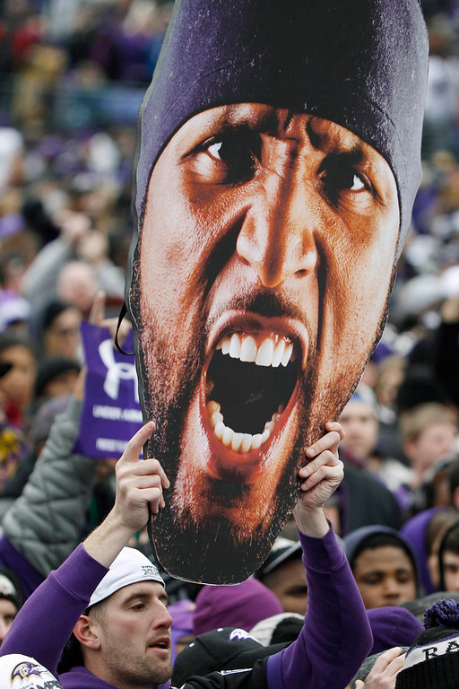 . A fan of Super Bowl XLVII champion Baltimore Ravens holds up a large cut-out of retiring linebacker Ray Lewis before a stadium rally in Baltimore February 5, 2013. The Ravens defeated the San Francisco 49ers to win the NFL championship.     REUTERS/Gary Cameron