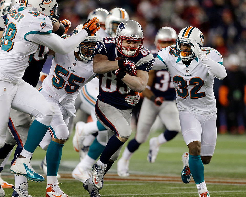 . Miami Dolphins linebackers Karlos Dansby (58), Koa Misi (55) and cornerback Dimitri Patterson (32) chase New England Patriots wide receiver Wes Welker (83) after a catch during the first quarter of an NFL football game in Foxborough, Mass., Sunday, Dec. 30, 2012. (AP Photo/Elise Amendola)