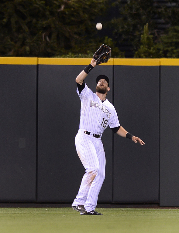 . DENVER, CO - JUNE 20: Colorado\'s Charlie Blackmon made a catch in center field. The Milwaukee Brewers defeated the Colorado Rockies 13-10 at Coors Field Friday night, June 20, 2014. Photo by Karl Gehring/The Denver Post