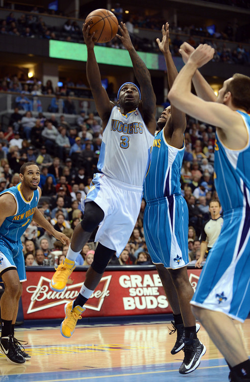 . DENVER, CO. - FEBRUARY 01: Ty Lawson of Denver Nuggets #3 drives for the basket against Darius Miller of New Orleans Hornets #2 in the 2nd half of the game on February 1, 2013 at the Pepsi Center in Denver, Colorado. Denver won 113-98. (Photo By Hyoung Chang/The Denver Post)