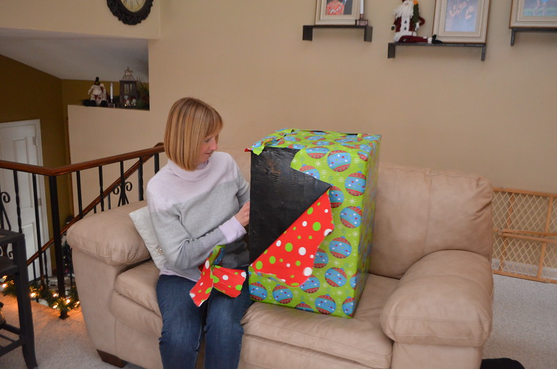 Kathy is not able to figure out what is in here.  It has a black plastic wrap around it.