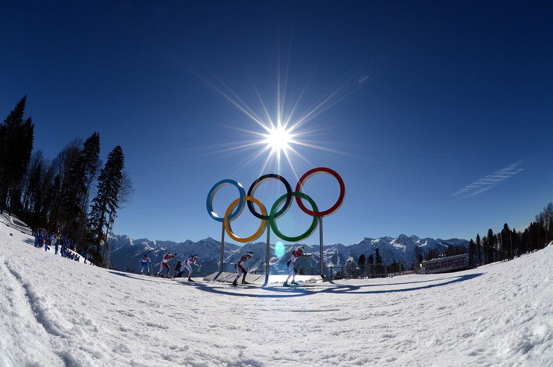 . Skiers compete by the Olympic Rings in the Women\'s Cross-Country Skiing 7,5km + 7,5km Skiathlon at the Laura Cross-Country Ski and Biathlon Center during the Sochi Winter Olympics on February 8, 2014 in Rosa Khutor. (KIRILL KUDRYAVTSEV/AFP/Getty Images)