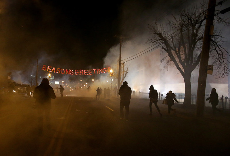 . Protestors run away after police deployed tear gas during a demonstration on November 24, 2014 in Ferguson, Missouri. A St. Louis County grand jury has decided to not indict Ferguson police Officer Darren Wilson in the shooting of Michael Brown that sparked riots in Ferguson, Missouri in August.  (Photo by Justin Sullivan/Getty Images)