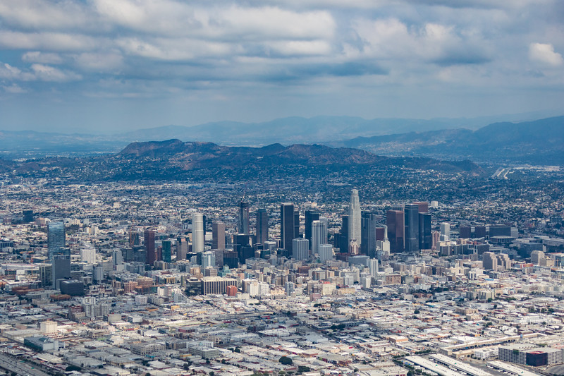 Aerial view of downtown Los Angeles, California and surrounding mountains
