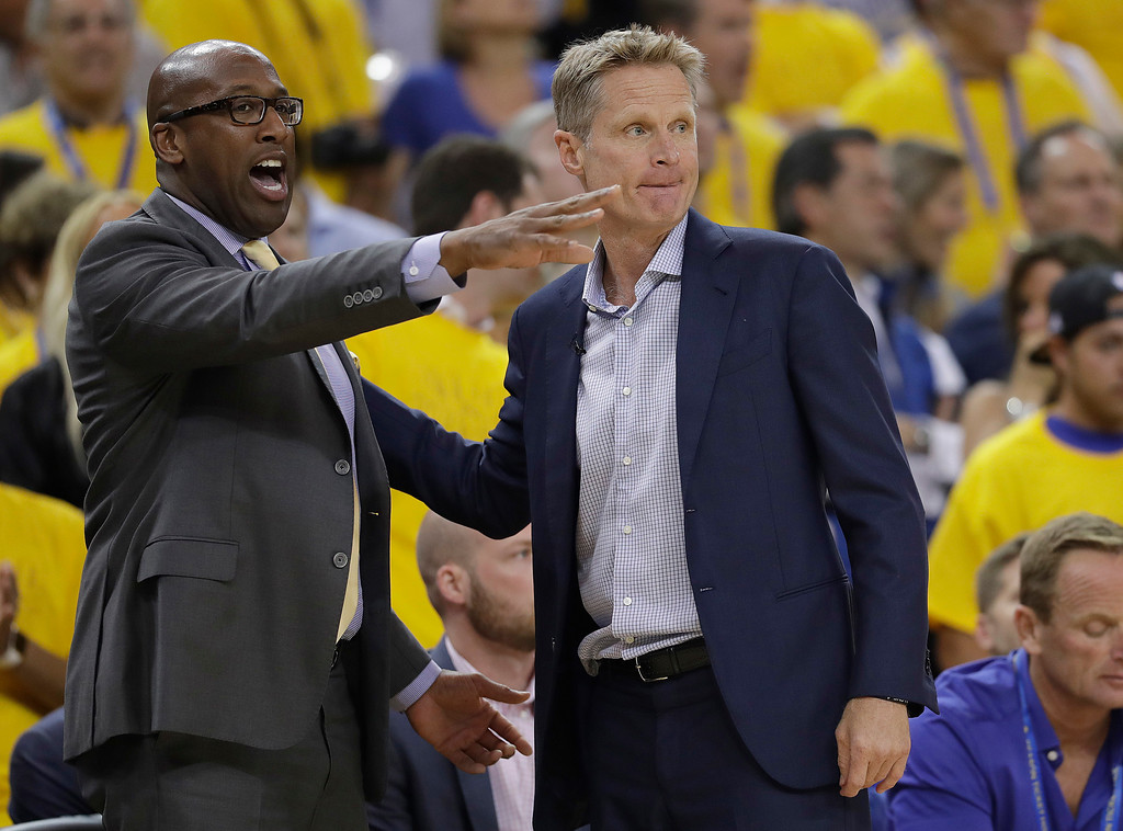 . Golden State Warriors head coach Steve Kerr, right, talks with assistant Mike Brown during the first half of Game 5 of basketball\'s NBA Finals between the Warriors and the Cleveland Cavaliers in Oakland, Calif., Monday, June 12, 2017. (AP Photo/Marcio Jose Sanchez)