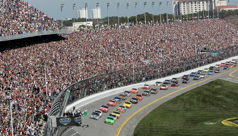 . Drivers take the green flag for the start of the NASCAR Daytona 500 auto race at Daytona International Speedway in Daytona Beach, Fla. Daytona International Speedway president Joie Chitwood announced, on Tuesday, Jan. 22, 2013, a proposed multi-year redevelopment of the historic racetrack.  The plan includes five new modern entrances, a second pedestrian bridge for easier access to the track and an expanded grandstand area with thousands of more seats.  (AP Photo/David Graham, File)