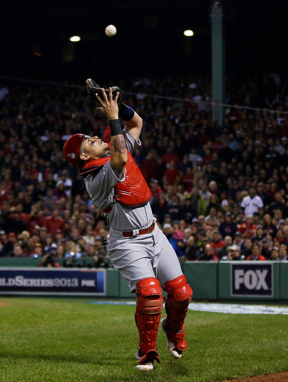 . St. Louis Cardinals catcher Yadier Molina catches a pop up by Boston Red Sox shortstop Xander Bogaerts during the second inning of Game 6 of baseball\'s World Series Wednesday, Oct. 30, 2013, in Boston. (AP Photo/Matt Slocum)