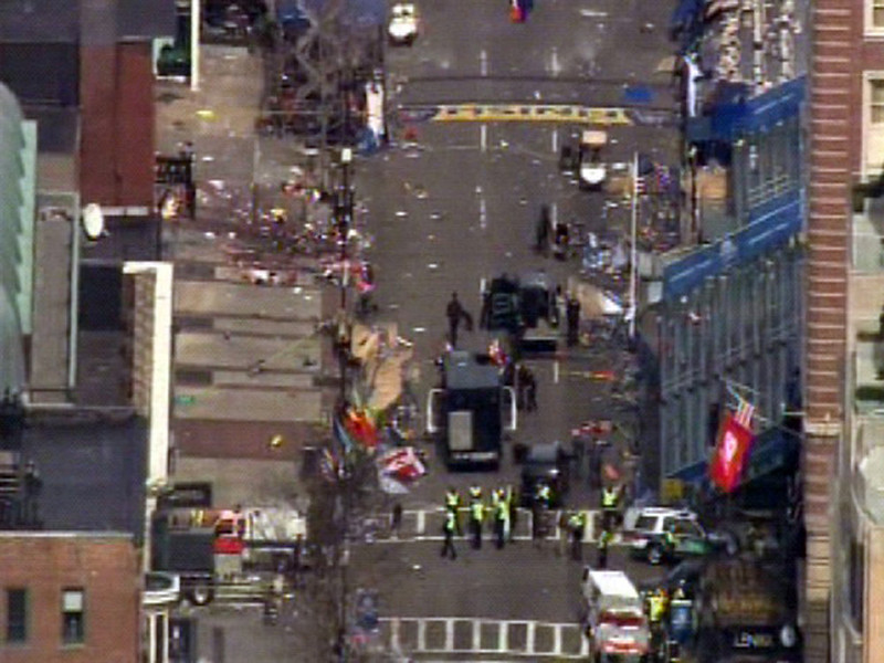 . Medical workers and authorities work on the scene near the finish line of the 2013 Boston Marathon following an explosion in Boston, Monday, April 15, 2013. (AP Photo/WCVB-TV/ABC)