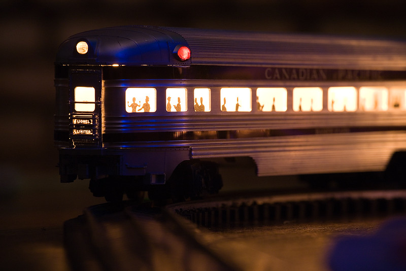 """My uncle's Lionel 2373 Canadian Pacific F-3 AA Diesel Locomotive Set from 1957. The set also includes (1) No. 2551 Canadian Pacific Illuminated """"Banff Park"""" Observation Car; and (3) Lionel No. 2552 Canadian Pacific Illuminated """"Skyline 500"""" Vista Dome Cars.  I also have 6 """"Plasticville, USA"""" houses; Ranch House (white/yellow), Church, School House, Fire House, Gas Station and Cape Code House (red)."""