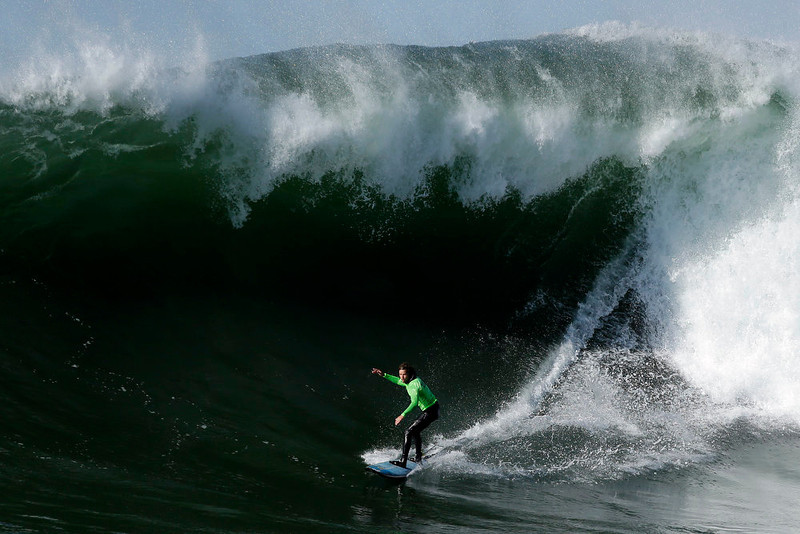 ". Grant ""Twiggy\"" Baker competes during the fourth heat of the Mavericks Invitational big wave surf contest in Half Moon Bay, Calif., Sunday, Jan. 20, 2013. (AP Photo/Marcio Jose Sanchez)"