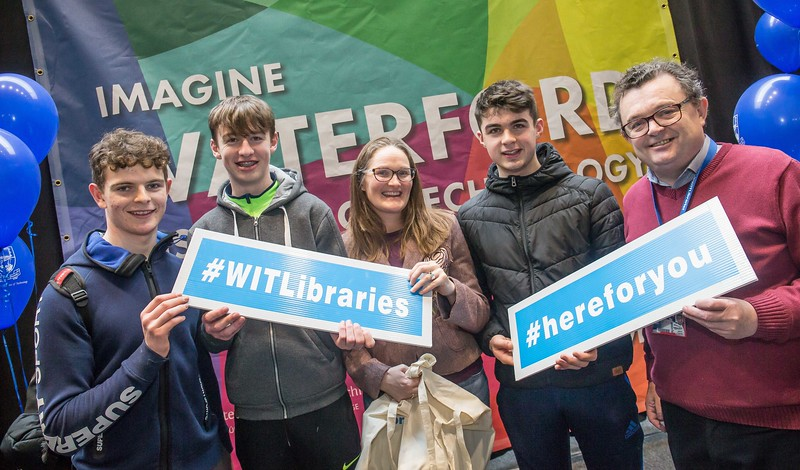 Padraig Bailey, Adam Bokle and Dylan Morrissey, Good Councel, New Ross with Clare Blount and Seamus Ryan, WIT Libraries during the Waterford Institute of Technology Schools' Open Day at the WIT Arena. On Saturday, 20 January, WIT is running another open day, the #StudyatWIT Open Day which will have information available on all courses available across WIT's schools of Lifelong Learning, Humanities, Engineering, Science & Computing, Health Sciences, Business. Picture: Pat Moore