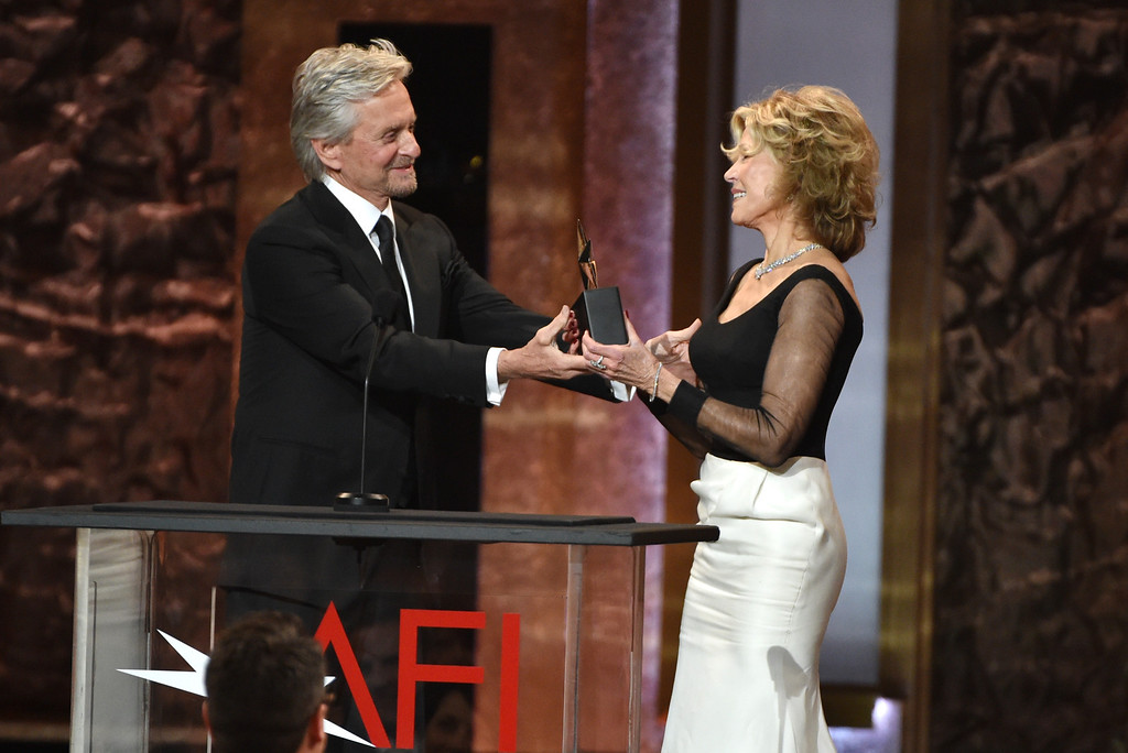. Michael Douglas, left, presents the AFI Lifetime Achievement Award to Jane Fonda at the 42nd AFI Lifetime Achievement Award Tribute Gala at the Dolby Theatre on Thursday, June 5, 2014, in Los Angeles. Looking on from left is Michael Douglas (Photo by John ShearerInvision/AP)