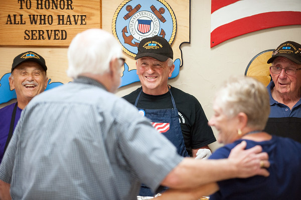 08/23/18 Wesley Bunnell | Staff Retired police and firefighters held their annual dinner at American Legion Post 2 on Thursday evening. Jim Bousquet, Commander of the Korean Veterans Station, L, Dave Peplau, middle, and Ed Testa smile as they chat and serve up dinner to guests.