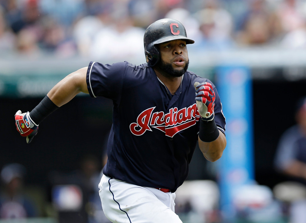 . Cleveland Indians\' Carlos Santana runs out a double off Texas Rangers relief pitcher Tanner Scheppers in the eighth inning of a baseball game, Thursday, June 29, 2017, in Cleveland. (AP Photo/Tony Dejak)