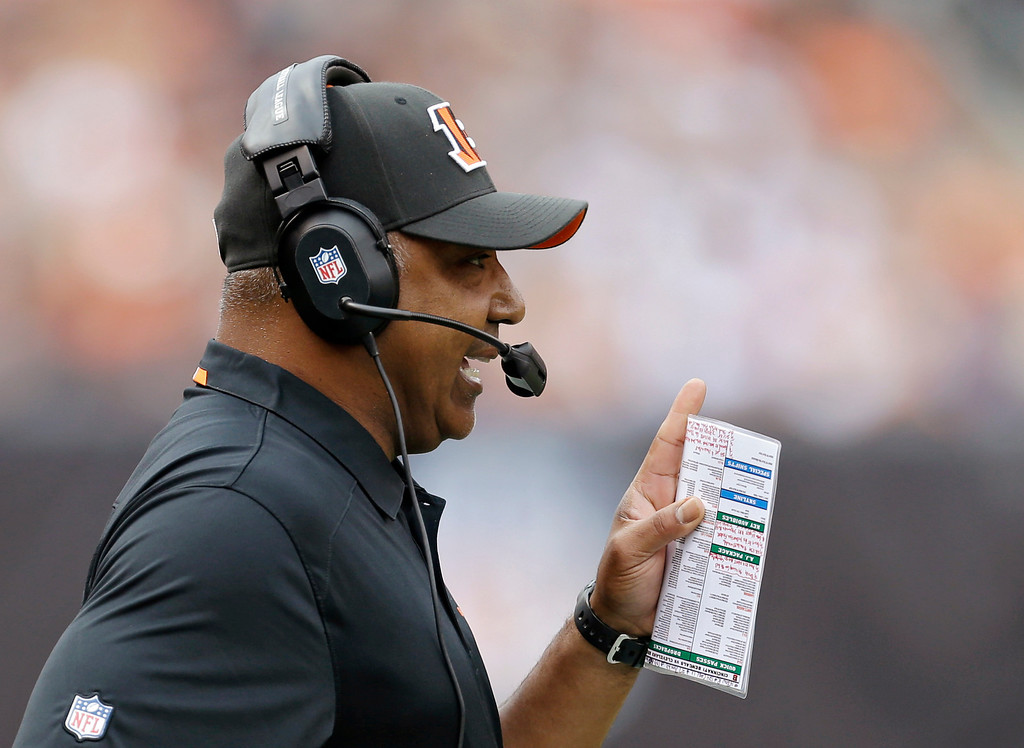 . Cincinnati Bengals head coach Marvin Lewis talks on his headset in the first quarter of an NFL football game against the Cleveland Browns Sunday, Sept. 29, 2013, in Cleveland. (AP Photo/Tony Dejak)