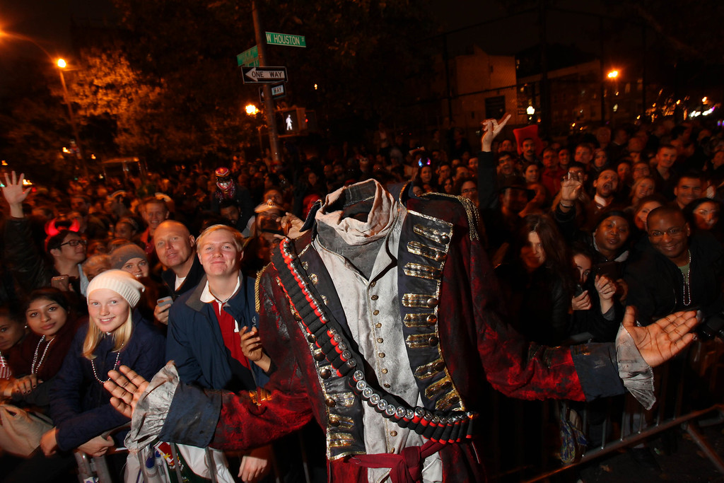 """. The 7-foot-tall Headless Horseman poses with fans during \""""Sleepy Hollow-een Headless Horseman Stunt\"""" at the Village Halloween Parade on Thursday, Oct. 31, 2013 in New York. (Photo by Omar Vega/Invision for FOX Broadcasting Company/AP)"""