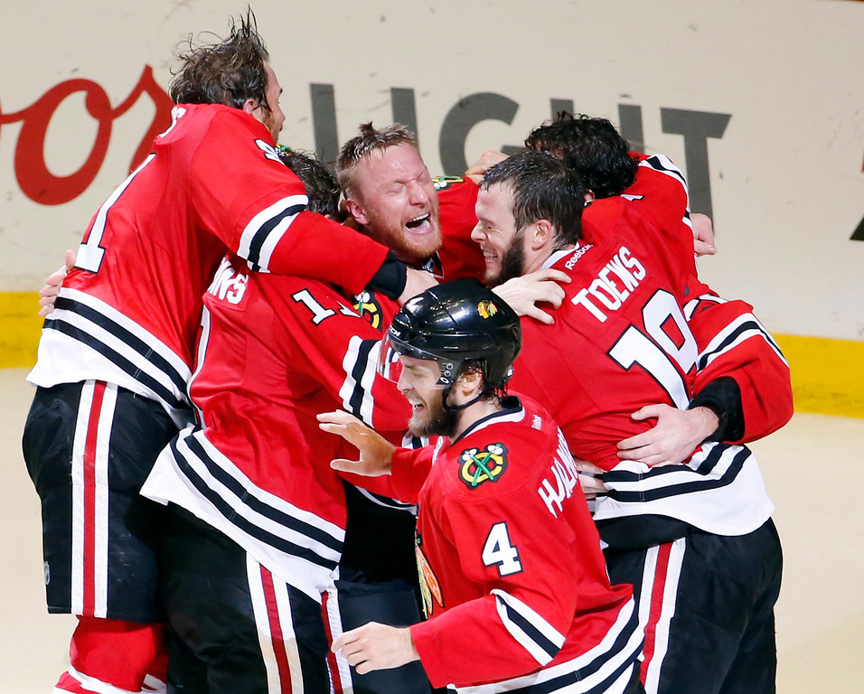. Members of the Chicago Blackhawks celebrate after defeating the Tampa Bay Lightning in Game 6 of the NHL hockey Stanley Cup Final series on Monday, June 15, 2015, in Chicago. The Blackhawks defeated the Lightning 2-0 to win the series 4-2. (AP Photo/Charles Rex Arbogast)