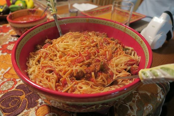 Homemade linguine with italian sausage red sauce