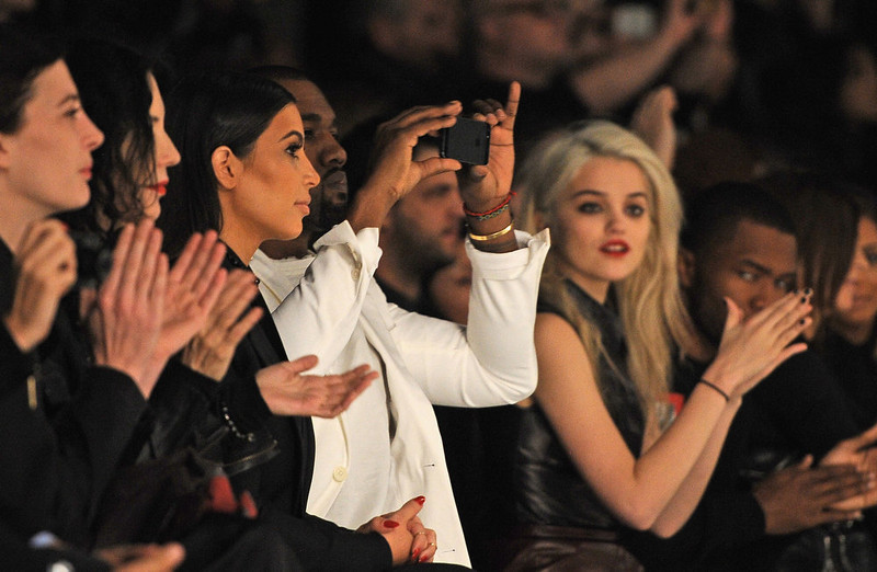 . Kim Kardashian (3rd L), Kanye West (4th L) and Sky Ferreira (R) attend the Givenchy Fall/Winter 2013 Ready-to-Wear show as part of Paris Fashion Week on March 3, 2013 in Paris, France.  (Photo by Pascal Le Segretain/Getty Images)