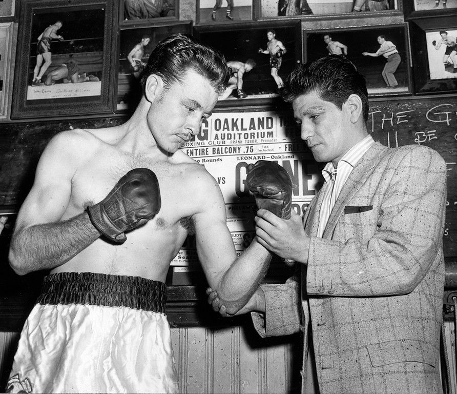 . February 24, 1955 - Jim Cody (left) gets pointers from Johnny Gonsalves. (Oakland Tribune Photo)