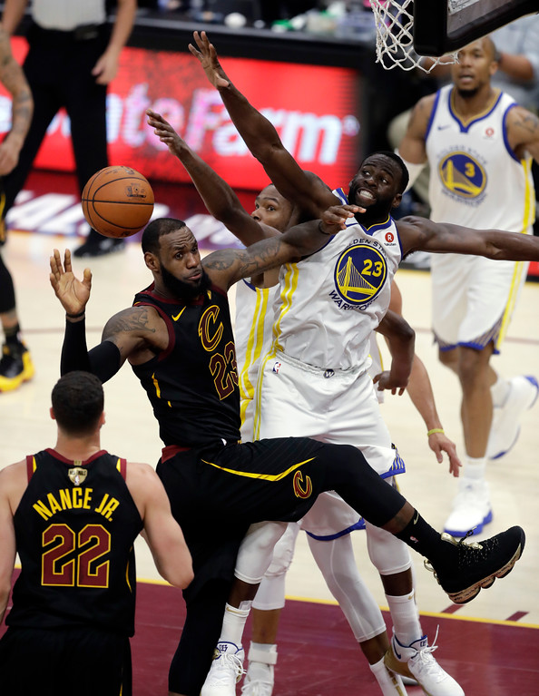 . Cleveland Cavaliers\' LeBron James is defended by Golden State Warriors\' Draymond Green during the second half of Game 4 of basketball\'s NBA Finals, Friday, June 8, 2018, in Cleveland. (AP Photo/Tony Dejak)