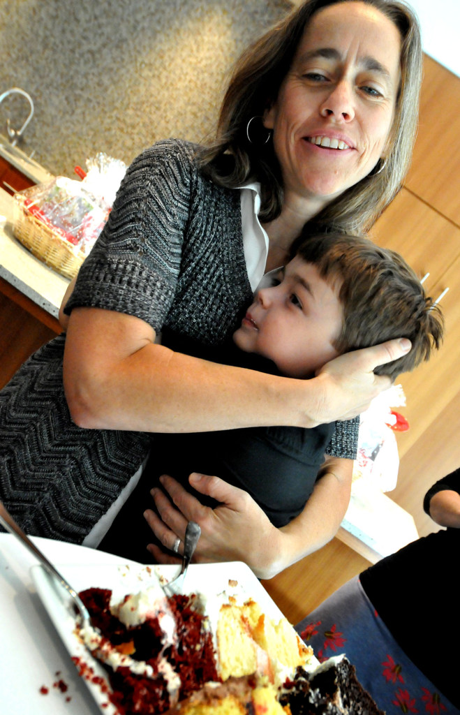 """. Margaret Miles hugs her5-year-old son, Louie ten Broeke, after he said he was \""""too full\"""" to eat anymore cake at the General Mills wedding cake taste test Monday morning. (Pioneer Press: John Doman)"""