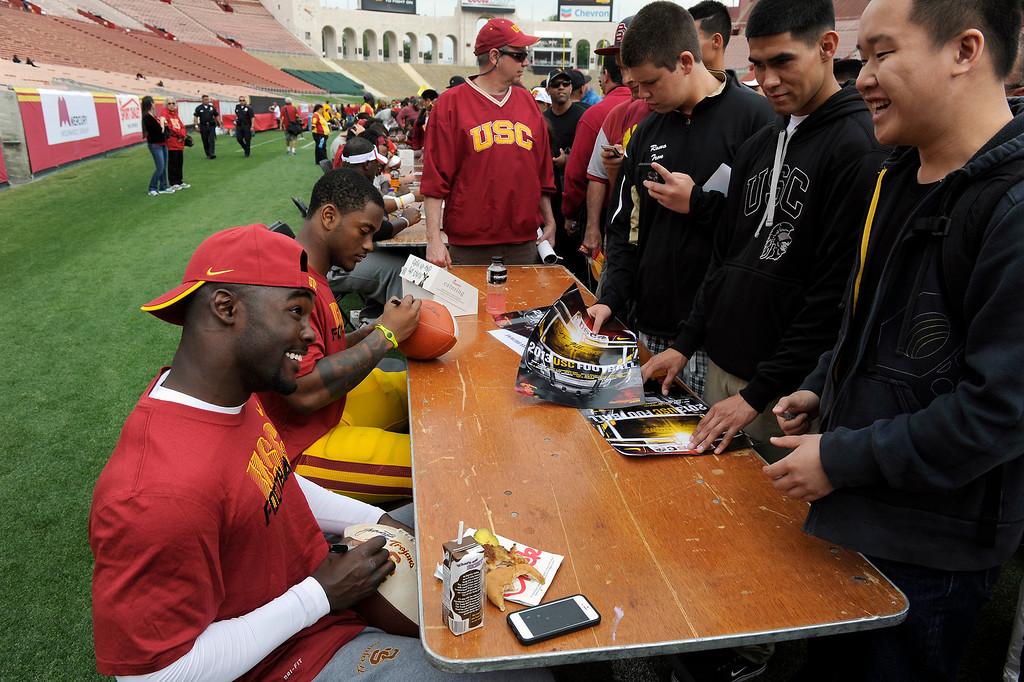 . RB Silas Redd signs autographs following USC\'s Spring Football Game at the L.A. Memorial Coliseum, Saturday, April 13, 2013. (Michael Owen Baker/Staff Photographer)