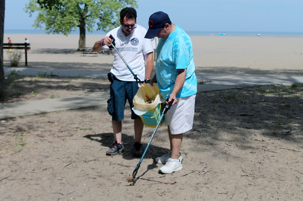 . Kristi Garabrandt � The News-Herald <br> Ed Probst and Tony Cervella participate  in Lake County Board of DD/Deepwood Recreation Service Program\'s  beach clean up project at Mentor Headlands Beach.