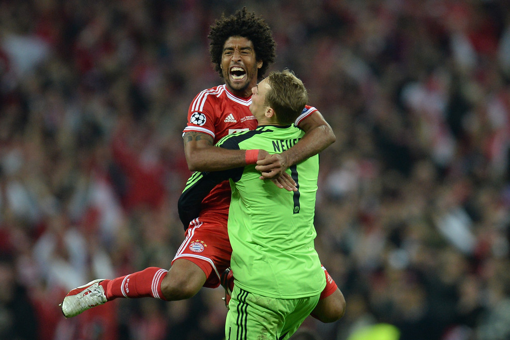 . Bayern Munich\'s Brazilian defender Dante celebrates with Bayern Munich\'s German goalkeeper Manuel Neuer (R) at the final whistle after their victory in the UEFA Champions League final football match between Borussia Dortmund and Bayern Munich at Wembley Stadium in London on May 25, 2013, Bayern Munich won the game 2-1.  PATRIK STOLLARZ/AFP/Getty Images