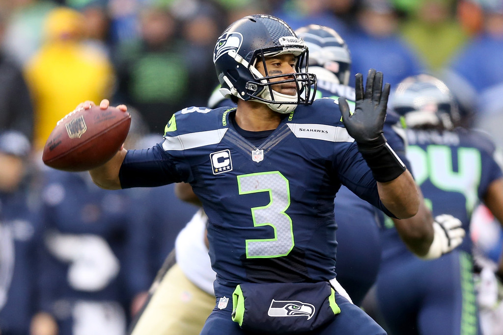 . SEATTLE, WA - JANUARY 11:  Quarterback Russell Wilson #3 of the Seattle Seahawks looks to pass the ball against the New Orleans Saints in the second quarter during the NFC Divisional Playoff Game at CenturyLink Field on January 11, 2014 in Seattle, Washington.  (Photo by Jeff Gross/Getty Images)