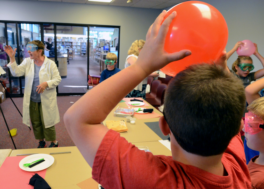 . Teacher Rosemary Carr leads children in experiments in Physical Science & Eelectricity during the GSK Science in Summer event at the Perkasie Branch of the Free Library of Bucks County on Tuesday July 22,2014.Photo by Mark C Psoras/The Reporter