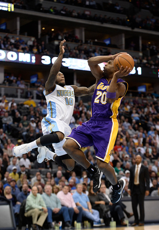 . DENVER, CO - NOVEMBER 13: Denver Nuggets point guard Nate Robinson (10) attempts to block a shot by Los Angeles Lakers shooting guard Jodie Meeks (20) on a fast break during the fourth quarter November 13, 2013 at Pepsi Center. (Photo by John Leyba/The Denver Post)