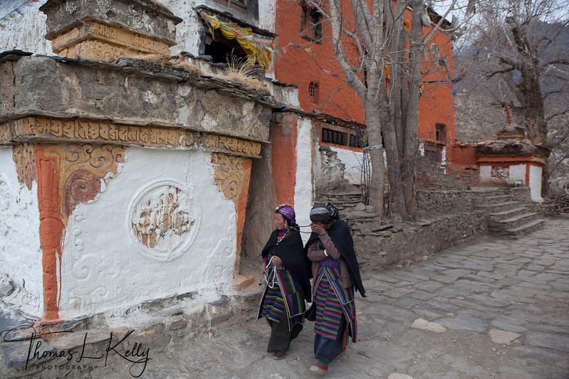 Mustangi women circumambulate Lo Ghyekar Goempa. Seen here is the main entrance to goempa. Mustang, Nepal.