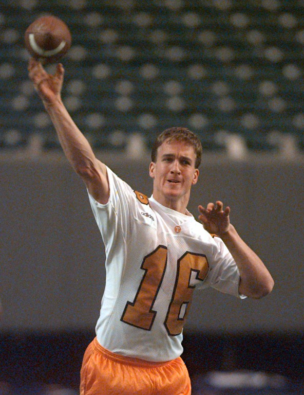 . Tennessee quarterback Peyton Manning loosens up his arm in Atlanta Friday, Dec. 5, 1997, before the Volunteer\'s last workout before Saturday\'s SEC Championship game against Auburn in the Georgia Dome.  (AP Photo/John Bazemore)