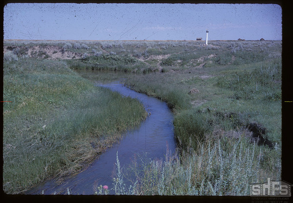Wood River crossing of NWMP Trail. McCord. 07/28/1962