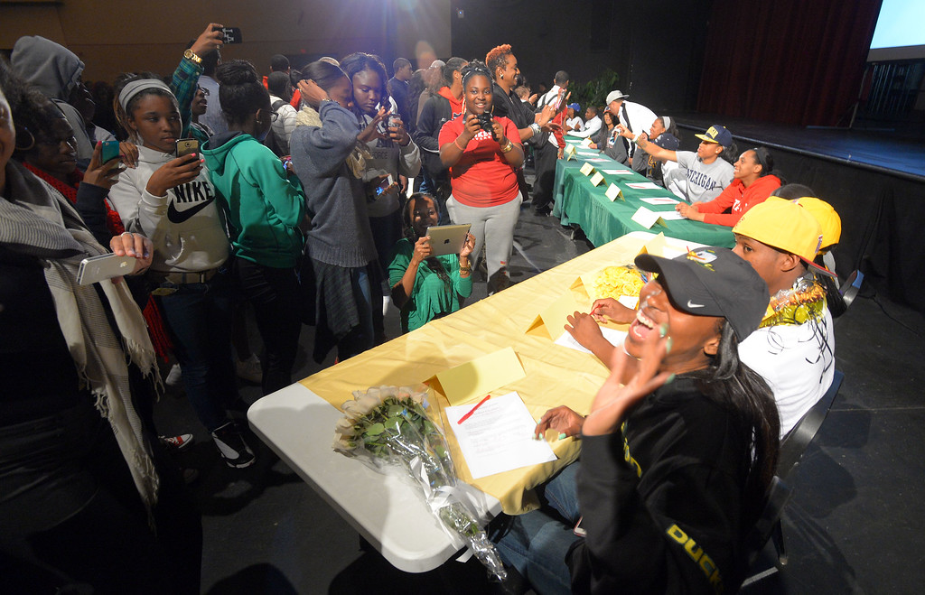 . 18 students athletes at Long Beach Poly pose for photos after signing their national letters of intent to play athletics at 4-year universities during a ceremony in Long Beach, CA on Wednesday, February 5, 2014. (Photo by Scott Varley, Daily Breeze)