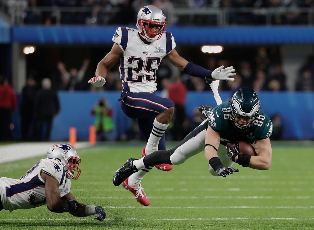 . Philadelphia Eagles tight end Zach Ertz (86) gets tripped by New England Patriots strong safety Jordan Richards (37) as cornerback Eric Rowe (25) watches, during the second half of the NFL Super Bowl 52 football game, Sunday, Feb. 4, 2018, in Minneapolis. (AP Photo/Tony Gutierrez)