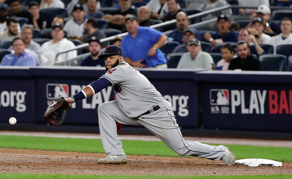 . Cleveland Indians first baseman Carlos Santana (41) can\'t pull in a bad throw from pitcher Danny Salazar during the fifth inning in Game 4 of baseball\'s American League Division Series against the New York Yankees, Monday, Oct. 9, 2017, in New York. Todd Frazier was safe at first on the play. (AP Photo/Frank Franklin II)